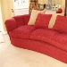 Curved red sofa with scatter cushions